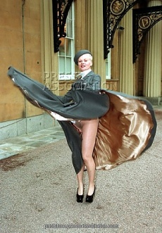 VIVIENNE WESTWOOD FASHION DESIGNER AT BUCKINGHAM PALACE WHERE SHE RECEIVED HER OBE FROM THE QUEEN, BUT BENEATH HER RESPECTABLE TAILORED SUIT SHE WORE NO KNICKERS